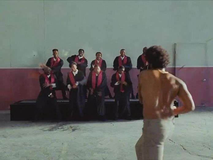 Gambino opens fire on a choir after singing and dancing with them What's behind the music video taking the world by storm? What's behind the music video taking the world by storm? skynews gambino childish gambino 4303865