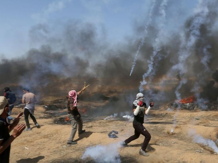 Tear gas canisters are fired by Israeli forces at Palestinian demonstrators Palestinians shot dead as 'volatile' Gaza border protest intensifies Palestinians shot dead as 'volatile' Gaza border protest intensifies skynews gaza palestinian protests 4306753