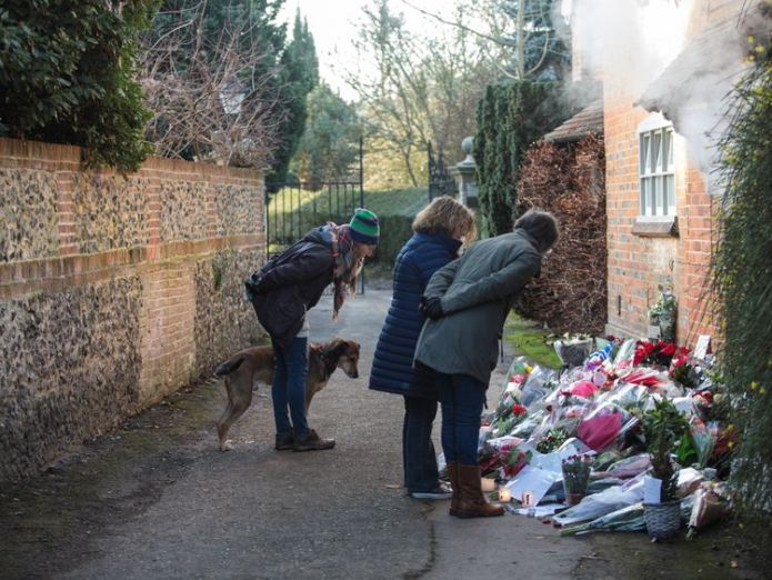 Flowers have mounted up outside the home in Oxfordshire home where Michael died George Michael's family ask fans to remove tributes from his homes George Michael's family ask fans to remove tributes from his homes skynews george michael oxforshire 4298946