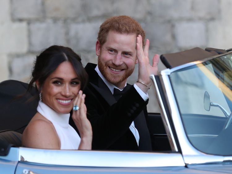 Prince Harry, Duke of Sussex, (R) and Meghan Markle, Duchess of Sussex, (L) leave Windsor Castle in Windsor on May 19, 2018 in an E-Type Jaguar after their wedding to attend an evening reception at Frogmore House. (Photo by Steve Parsons / POOL / AFP) (Photo credit should read STEVE PARSONS/AFP/Getty Images)
