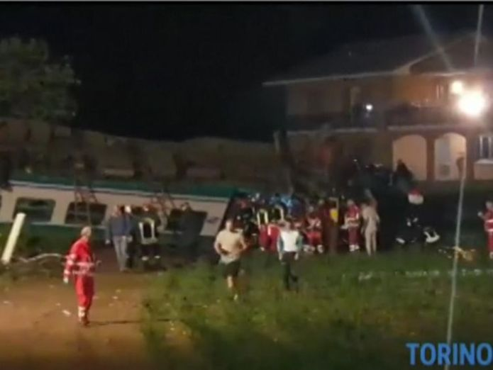 The crash took place near the city of Turin Two dead and 18 injured after train ploughs into truck Two dead and 18 injured after train ploughs into truck skynews italy train 4318632