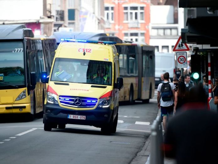 An ambulance at the scene of the shooting in Liege prisoner kills two female officers with own guns in liege attack Prisoner kills two female officers with own guns in Liege attack skynews liege shooting belgium 4323420