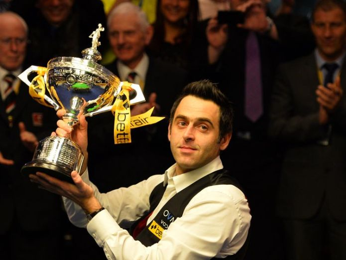 Ronnie O'Sullivan holds his trophy aloft after winning the World Championship in 2013