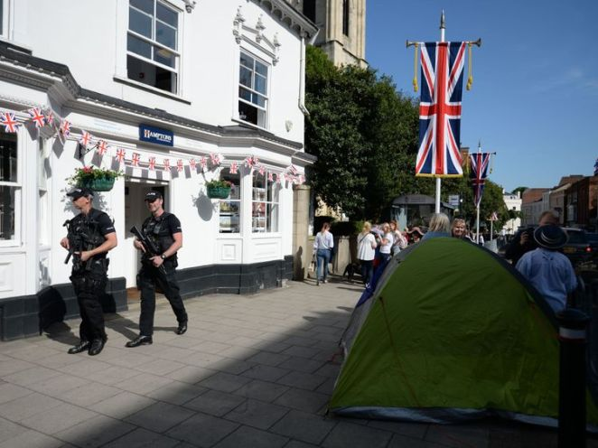 Armed police walk through the centre of Windsor ahead of the royal wedding
