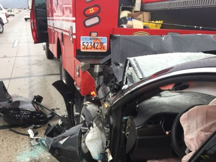 The fire truck was stopped at a red light when the Tesla drove into it at 60mph. Pic: South Jordan Police Department Tesla with autopilot crashes into truck at red light Tesla with autopilot crashes into truck at red light skynews tesla utah south jordan 4308438