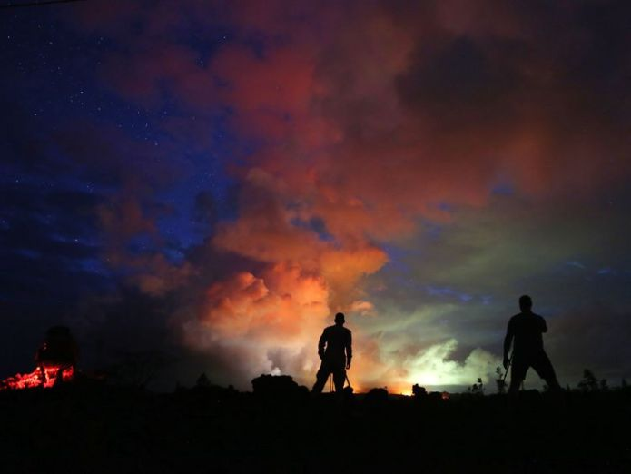 Photographers look on as lava from active fissures illuminates volcanic gases Roads ripped up by rumbling Big Island Hawaii volcano Roads ripped up by rumbling Big Island Hawaii volcano skynews volcano hawaii kilauea 4312259