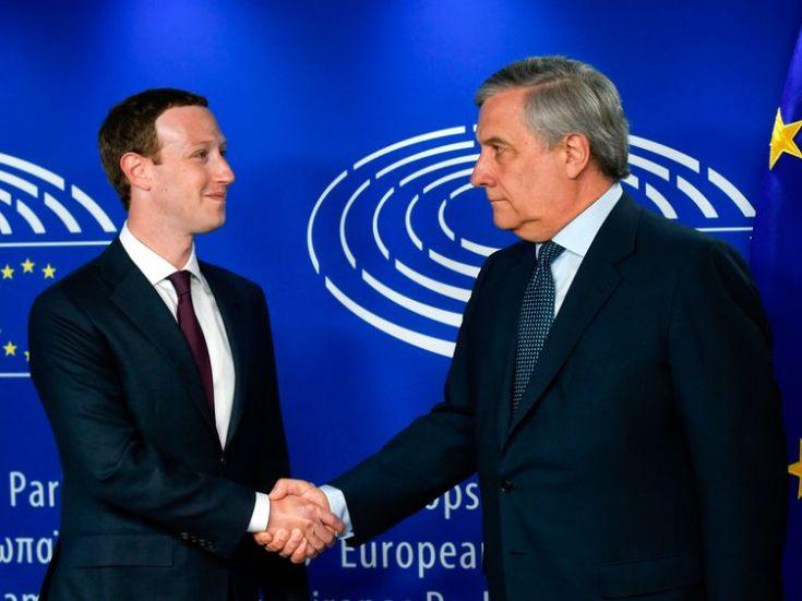 European Parliament President Antonio Tajani (R) welcomes Facebook CEO Mark Zuckerberg (L) at the European Parliament