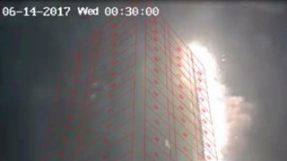 CCTV footage at 1:30am that shows the fire reached the roof on the North East corner