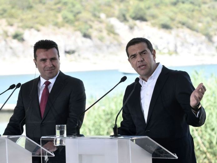 Greek Prime Minister Alexis Tsipras, right, and Macedonian Prime Minister Zoran Zaev at the ceremony Protests in Greece as Macedonia is renamed after 27-year row Protests in Greece as Macedonia is renamed after 27-year row skynews alexis tsipras zoran zaev 4338535