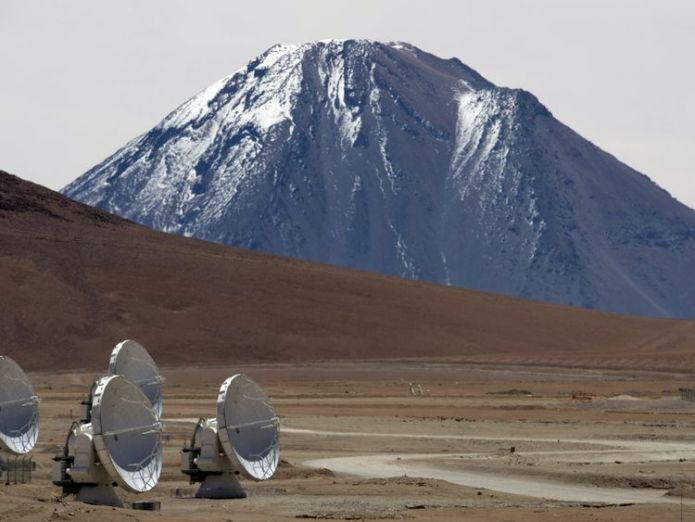 Radio telescope antennas of the ALMA (Atacama Large Millimeter/submillimeter Array) project, in the Chajnantor plateau, Atacama desert, some 1500 km north of Santiago, on March 12,2013. The ALMA, an international partnership project of Europe, North America and East Asia with the cooperation of Chile, is presently the largest astronomical project in the world. On Wednesday March 13 will be opened 59 high precision antennas, located at 5000 of altitude in the extremely arid Atacama desert. AFP PH Three baby planets spotted forming around infant star Three baby planets spotted forming around infant star skynews alma atacama chile 4335722