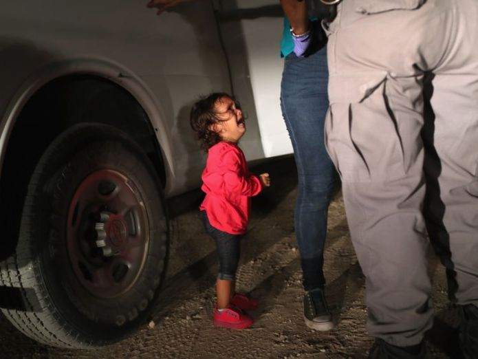A two year old Honduran asylum seeker cries as her mother is searched and detained Hundreds of lone children kept in cages in US Border Patrol 'prison' Hundreds of lone children kept in cages in US Border Patrol 'prison' skynews asylum seeker us immigration 4339013