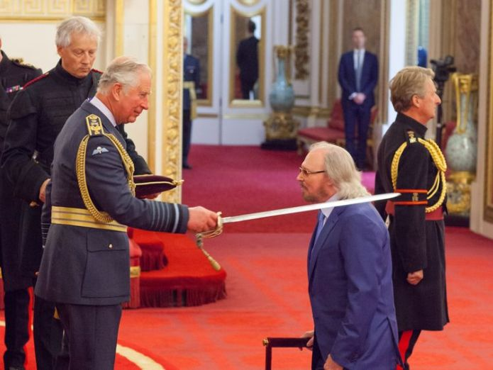 Sir Barry Gibb from Beaconsfield is made a Knight Bachelor of the British Empire by the Prince of Wales at Buckingham Palace. PRESS ASSOCIATION Photo. Picture date: Tuesday June 26, 2018. Photo credit should read: Dominic Lipinski/PA Wire                                      Bee Gee Barry Gibb 'thought knighthood was a wind-up' Bee Gee Barry Gibb 'thought knighthood was a wind-up' skynews barry gibb bee gees 4346317