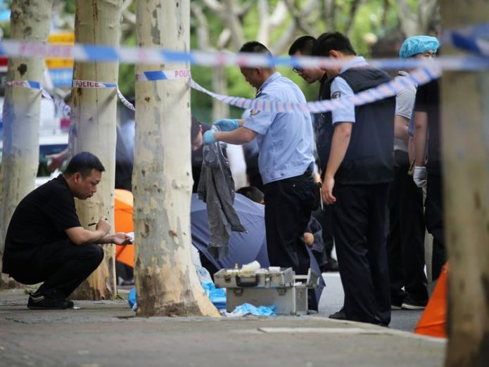 The area was cleaned with a hose man kills two children with kitchen knife in shanghai street attack Man kills two children with kitchen knife in Shanghai street attack skynews china shanghai xuhui 4347794