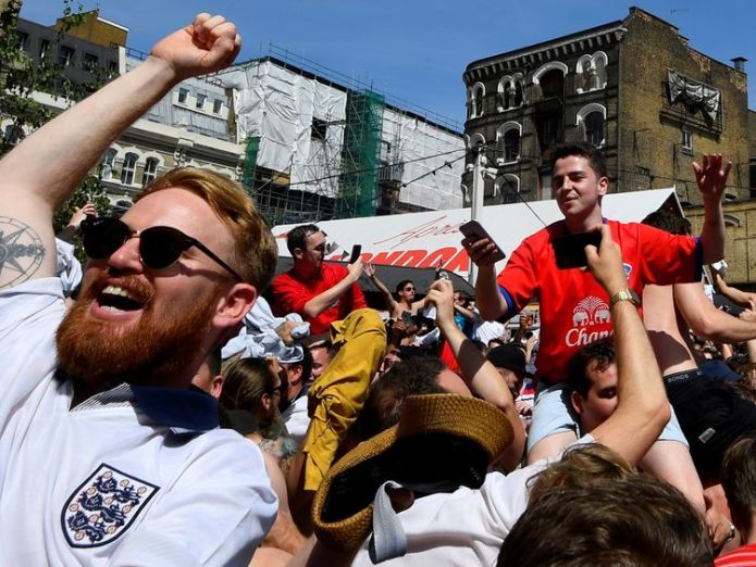 England fans in London celebrate as the team scores Team through to knockout stage of World Cup Team through to knockout stage of World Cup skynews england fans 4344687