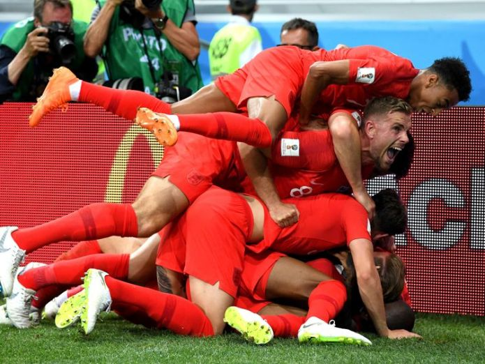 Harry Kane was mobbed by his teammates after his late winner England support at World Cup 'lowest for 30 years', supporters group says England support at World Cup 'lowest for 30 years', supporters group says skynews england world cup 4339711