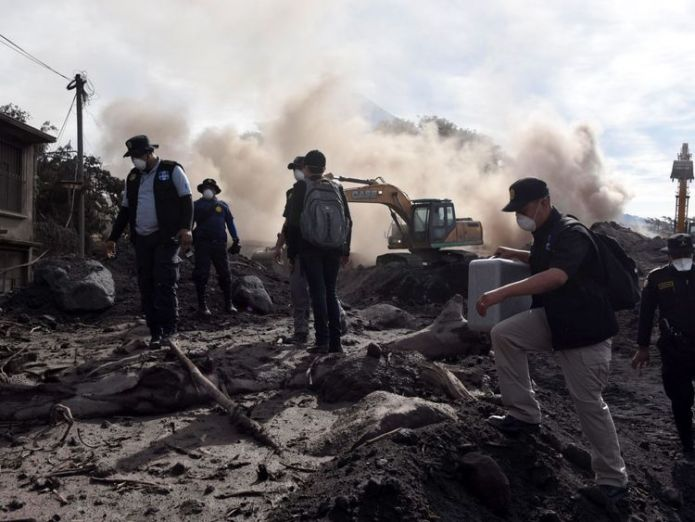 Police officers search for victims of the Fuego Volcano eruption Chance of finding anyone alive 'practically non-existent' Chance of finding anyone alive 'practically non-existent' skynews fuego volcano guatemala 4329813