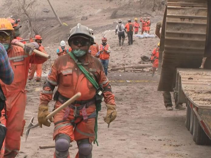 An excavator arrives to help with the digging Firefighters buried under tonnes of volcanic ash in Guatemala Firefighters buried under tonnes of volcanic ash in Guatemala skynews ian woods guatemala 4329800