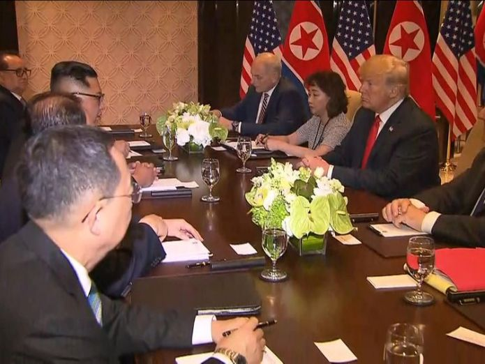 The US and North Korean delegations sitting around a table Donald Trump confident of 'terrific relationship' with Kim Jong Un Donald Trump confident of 'terrific relationship' with Kim Jong Un skynews kim trump 4333778