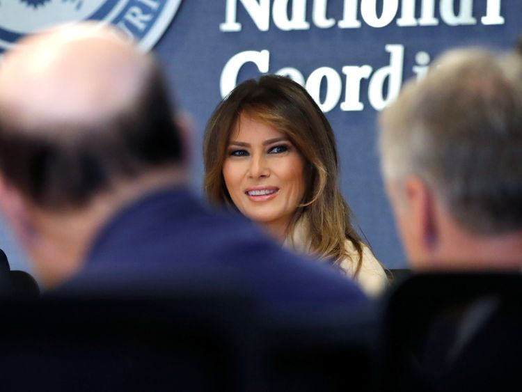 Melania Trump smiles during a hurricane response briefing at the FEMA