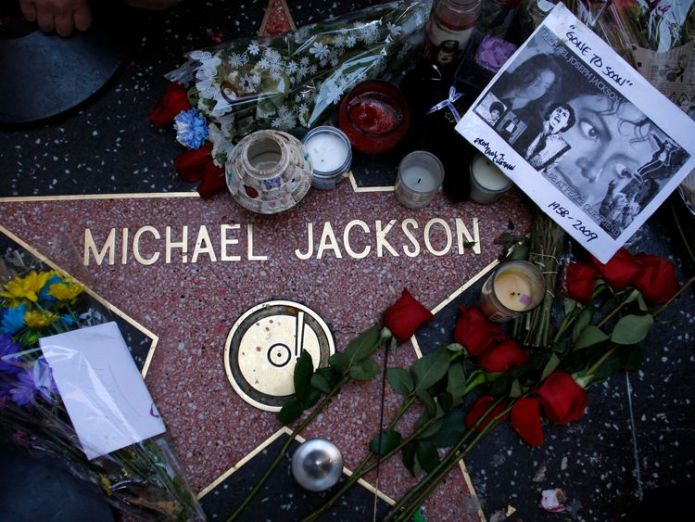 Fans pay tribute to Michael Jacson by laying flowers on his star Jeff Goldblum gets Hollywood Walk of Fame star Jeff Goldblum gets Hollywood Walk of Fame star skynews michael jackson hollywood 4336681