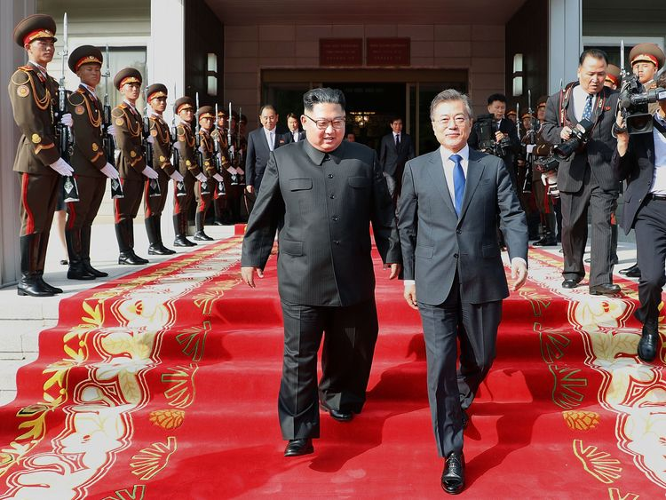 In this handout image provided by South Korean Presidential Blue House, South Korean President Moon Jae-in (R) walks with North Korean leader Kim Jong-un (L) during their meeting on May 26, 2018 in Panmunjom, North Korea