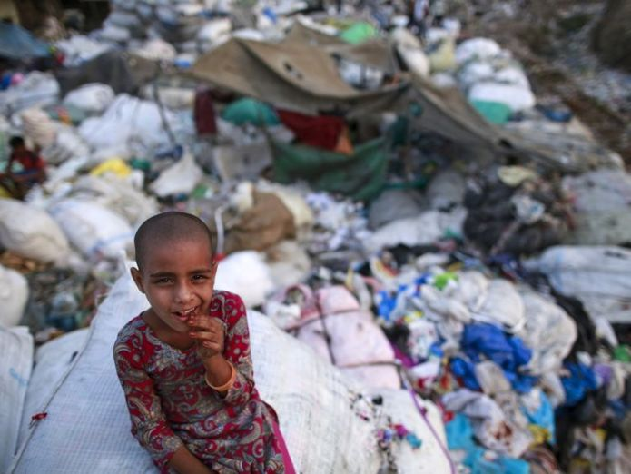 A girl sits among discarded rubbish in a Mumbai slum All disposable plastic banned in Mumbai and surrounding state All disposable plastic banned in Mumbai and surrounding state skynews mumbai plastic rubbish 4346020