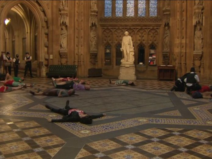 Protesters lie down in the Houses of Parliament ahead of a vote on Heathrow's expansion Heathrow Airport third runway backed by MPs in Commons vote Heathrow Airport third runway backed by MPs in Commons vote skynews parliament heathrow 4345749