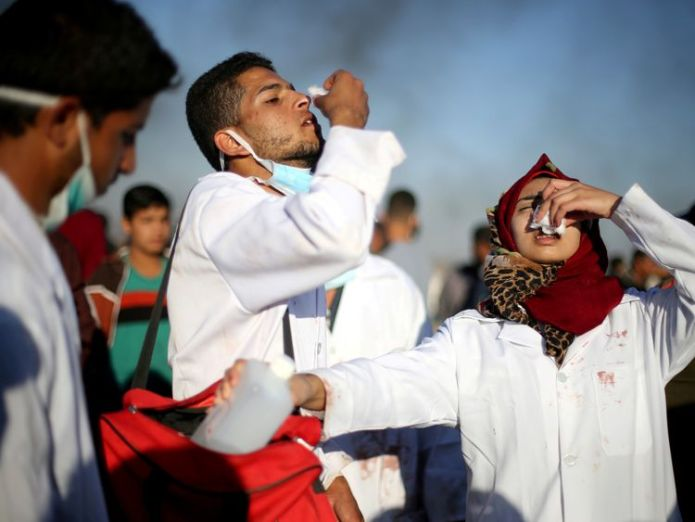 Razan Al-Najar, far right, working during a tear gas attack in Gaza in April Hamas warns of 'bloodier' Gaza protests and demands easing of economic blockade Hamas warns of 'bloodier' Gaza protests and demands easing of economic blockade skynews razan al najar gaza 4327144