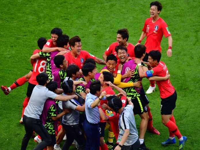 South Korea celebrate their late winner Holders Germany crash out of World Cup after losing 2-0 to South Korea Holders Germany crash out of World Cup after losing 2-0 to South Korea skynews south korea germany 4347249