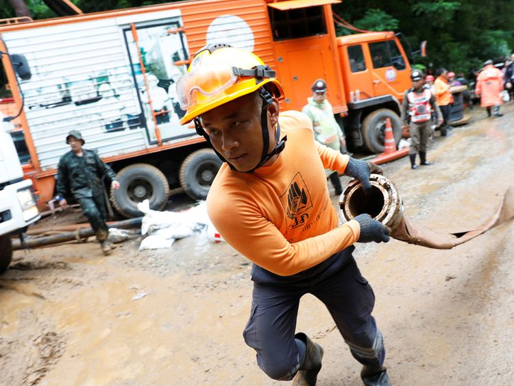 A rescue team member works near the Tham Luang cave complex, as a search for members of an under-16 soccer team continues
