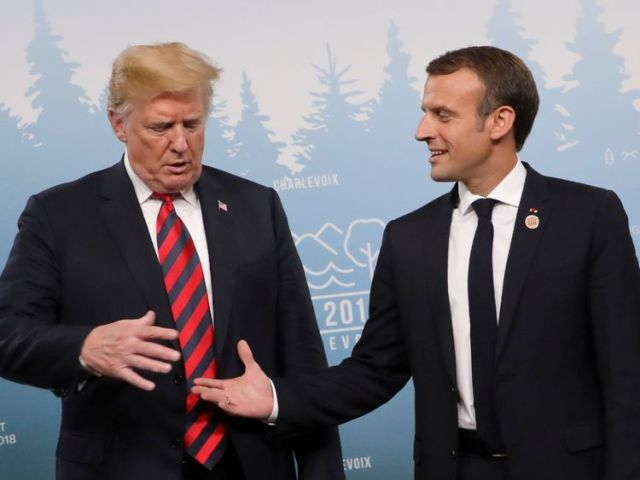 Trump looks warily at Macron's out-stretched hand