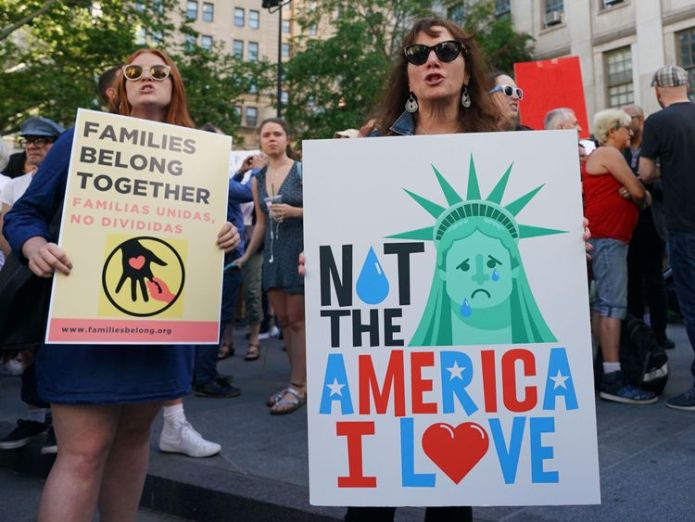 People attend a rally protesting the separation of children from their families while crossing the US border illegally on June 14, 2018 in New York Judge orders US border families must be reunited within 30 days Judge orders US border families must be reunited within 30 days skynews us children families 4340424
