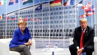 Donald Trump and Angela Merkel attend a bilateral meeting during the NATO summit  NATO allies should double defence spend goal skynews donald trump angela merkel 4359187