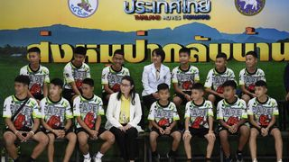 Rescued Thai boys at a news conference  Thai cave boys pray for protection from misfortunes as they visit Buddhist temple skynews rescued thai boys cave 4365085