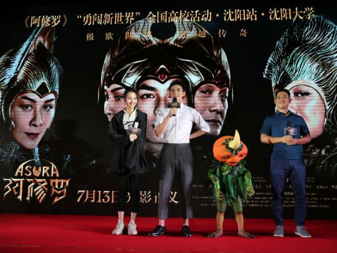 Director Zhang Peng (R) and actors Wu Lei (2nd L) and Zhang Yishang attend a promotional event for the movie Asura in Shenyang,  China's most expensive film is withdrawn after it flops skynews asura china film flop 4364377