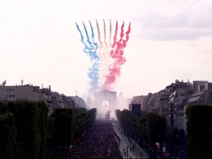 The Patrouille de France trailing blue, white and red smoke  France fans pack Champs Elysees in Paris to get glimpse of World Cup winners skynews france paris world cup 4363797