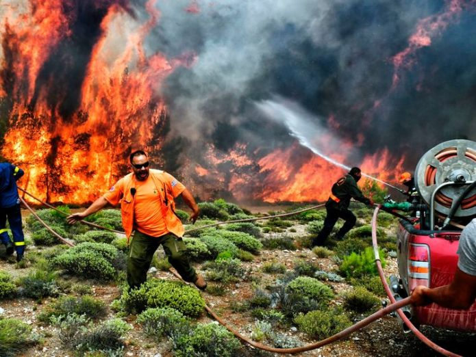 Firefighters and volunteers try to extinguish flames during a wildfire at the village of Kineta, near Athens  'Serious indications' deadly Greece wildfire was arson skynews greece wildfire kineta 4370778