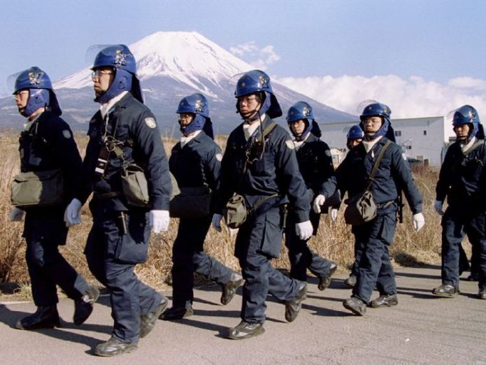 A police squad leave a Aum Shinri Kyo (Supreme Truth Sect) compound after finishing their shift in the small village of Kamikuishiki at the foot of Mount Fuji in this March 28, 1995 file photo  Final members of sarin attack cult are executed in Japan skynews kamikuishiki aum fuji 4371733