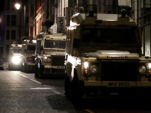 Police vehicles on Butcher street in Londonderry as disorder has flared in the city for a sixth successive night