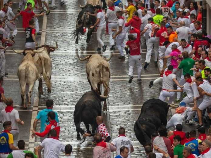 Five people have been badly injured during the first running of the bulls in Pamplona  Man gored and four badly injured on first day of Pamplona bull run skynews pamplona bull run 4356189