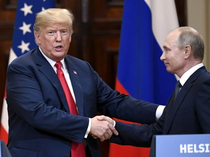 U.S. President Donald Trump and Russia's President Vladimir Putin shake hands after their joint news conference in the Presidential Palace in Helsinki, Finland  I 'mis-spoke' at Putin press conference skynews putin trump summit 4363695