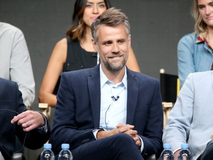 The presenter was taken off a plane from the US in a wheelchair  Presenter Richard Bacon 'getting better' after being placed in induced coma skynews richard bacon coma 4361185