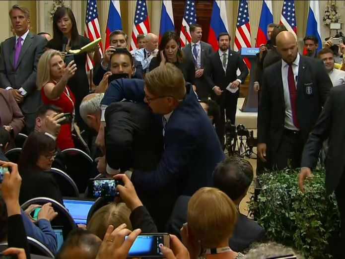 Protester being held ahead of Trump and Putin's news conference  Man dragged out of Trump-Putin news conference skynews russia trump 4363601