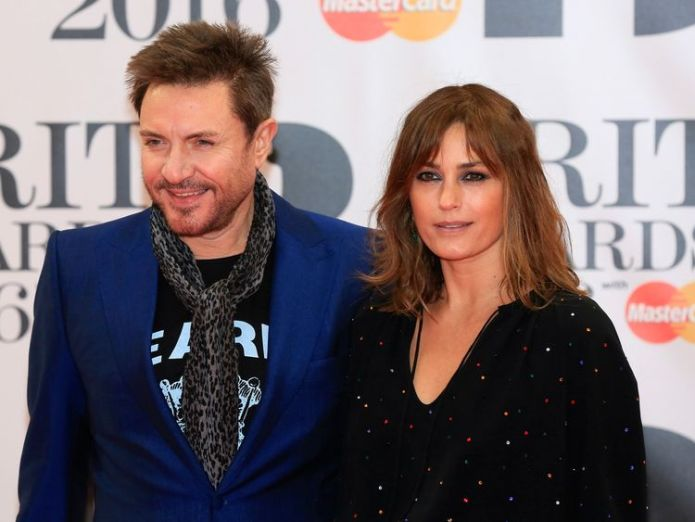 The popstar has been married to model Yasmin for 33 years  Duran Duran's Simon Le Bon denies sexual assault claim skynews simon le bon duran duran 4360303