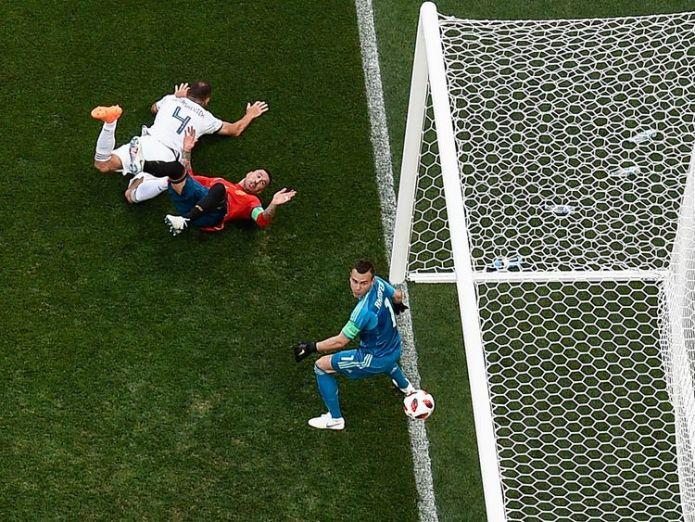 Sergei Ignashevich deflects a Marco Asensio free-kick into his own net  Russia stun Spain on penalties to make last eight skynews spain russia world cup 4350603