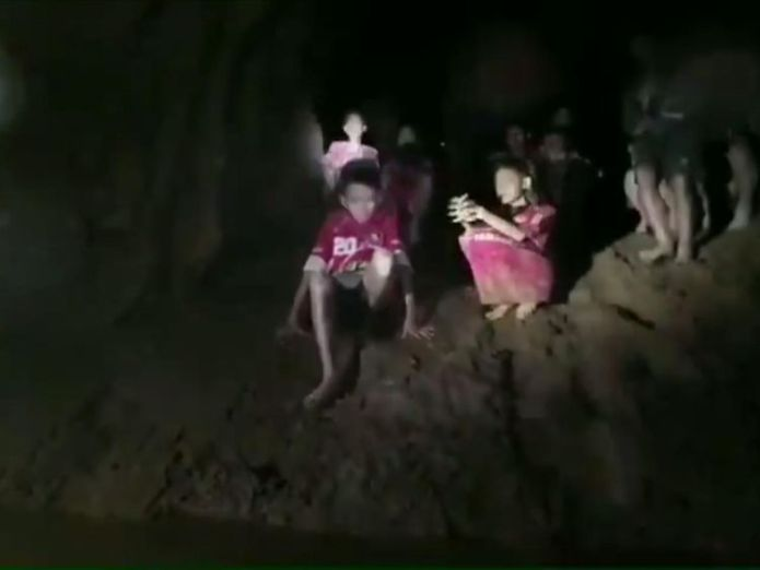 First images of rescued Thai teens   Moment British diver reaches boys lost in Thai cave for 10 days skynews thailand teens cave 4351633