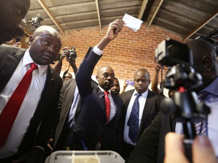 Nelson Chamisa held his ballot paper in the air as he voted in Harare  Zimbabweans vote in first election without Robert Mugabe on ballot paper skynews zimbabwe nelson chamisa 4375612