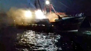Smoke bombs are reported to have been thrown at English and Scottish vessels. Pic: Anthony Quenel  May calls for 'amicable solution' to scallops row after French fishermen 'attack' skynews scallop fishermen french petrol bombs 4404335