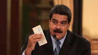 Venezuela's President Nicolas Maduro holds a bank note from the new currency Bolivar Soberano (Sovereign Bolivar)  Women turn to sex work in Colombia amid economic crisis skynews venezuela nicolas maduro 4394814