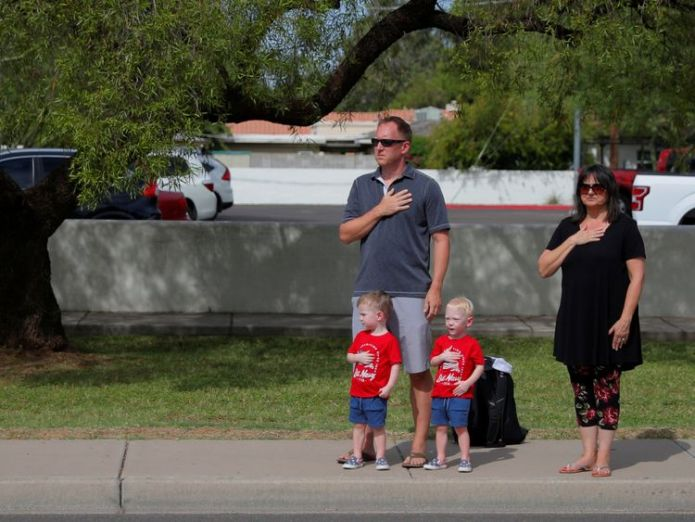 A family pays their respects as the motorcade passes  Joe Biden wipes a tear as he pays tribute to 'brother' John McCain skynews john mccain funeral 4406220